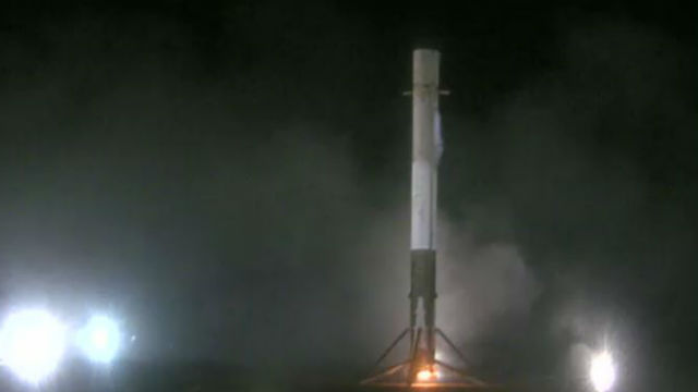 The Falcon 9 booster seconds after landing at Cape Canaveral.