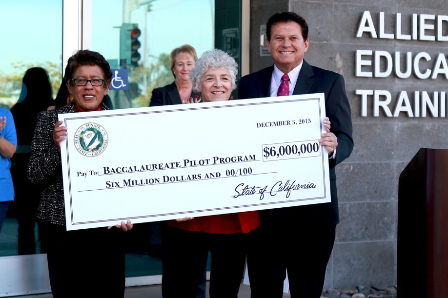 Sen. Marty Block presents a check for $6 million to Maria Nieto Senour, president of the SDCCD Board of Trustees (center) and Constance Carroll, chancellor of the San Diego Community College District.