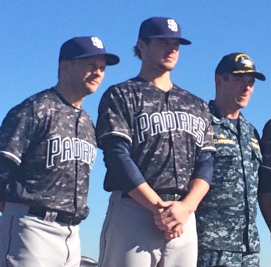 The jersey features the updated Padres wordmark across the chest and an American flag patch on the left sleeve.
