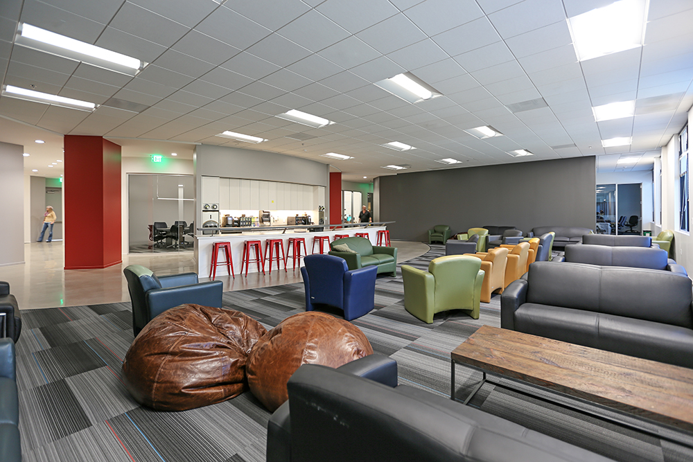 Pacific Building Group finishes office renovation for Daybreak Game Company, complete with low lighting and acoustic ceilings for maximum comfort.