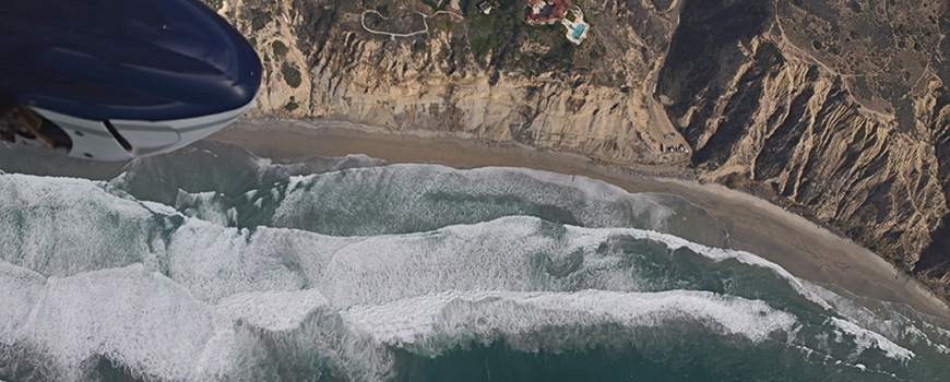San Diego coastline as seen from aircraft bearing instruments that make precision measurements of beach topography. (Courtesy Scripps Institution of Oceanography)