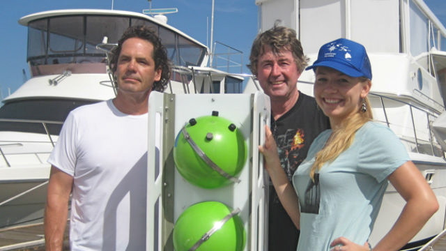 Rodney Moll (left), Kevin Hardy, and Natalya Gallo with a 'nanolander' developed to deploy deep-sea instruments. (Photo courtesy Scripps Institution of Oceanography)