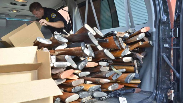 About 230 weapons were loaded into a police van after a buyback event. (Photo by Chris Stone)