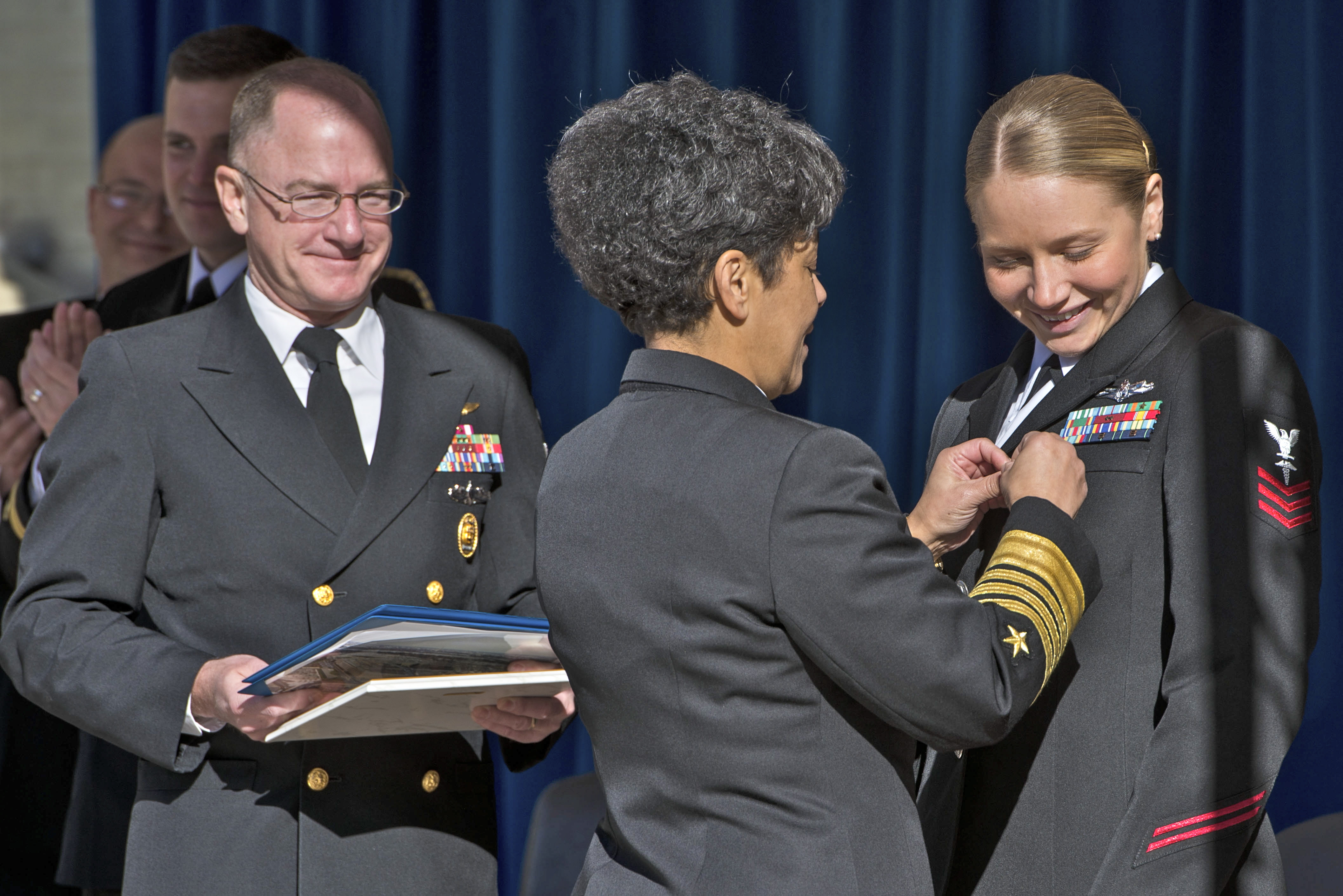 Vice Chief of Naval Operations Michelle Howard presents an award to Hospital Corpsman 1st Class Jessica Wentlent upon her selection as the 2015 Shore Sailor of the Year during a ceremony at the Pentagon. (U.S. Navy photo by Mass Communication Specialist 3rd Class Jackie Hart)