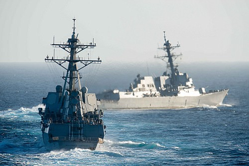 The guided-missile destroyers USS William P. Lawrence and USS Stockdale take part in a show of force demonstration, Aug. 4, 2015.