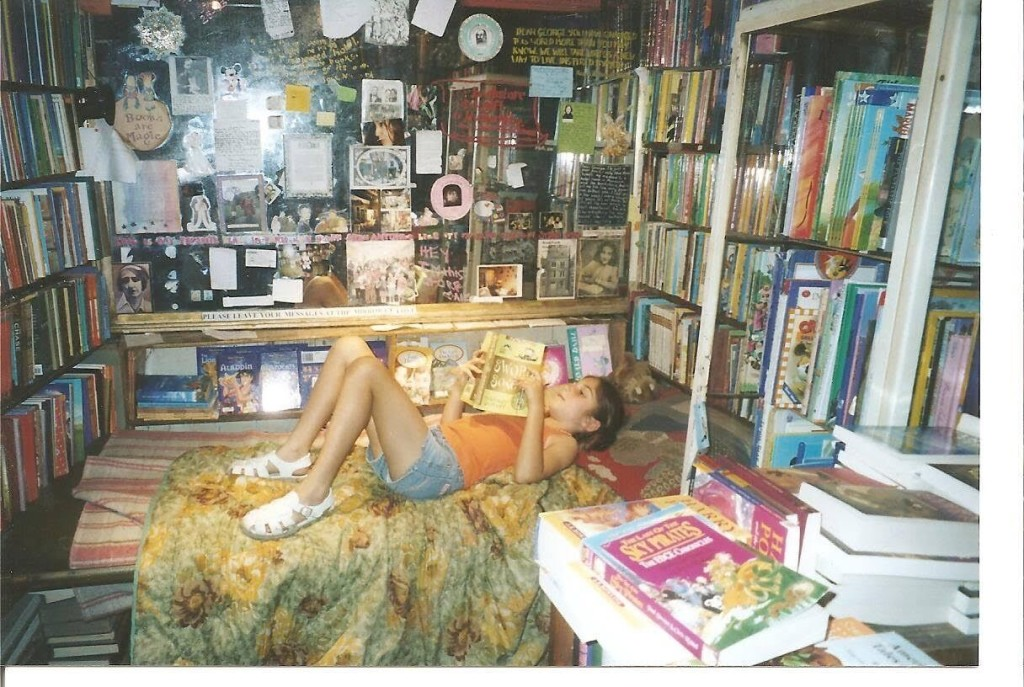 Katie, at age 8, reads a books from a Shakespearean bookstore in Paris.