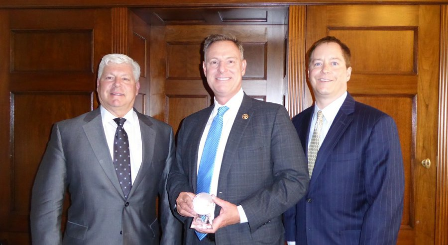 Congressman Scott Peters (center) receives the 2016 BIO Legislator of the Year Award. With him are Joe Panetta (left), president and CEO of Biocom, and Todd Gillenwater, executive vice president of CLSA. (Courtesy of BIO)