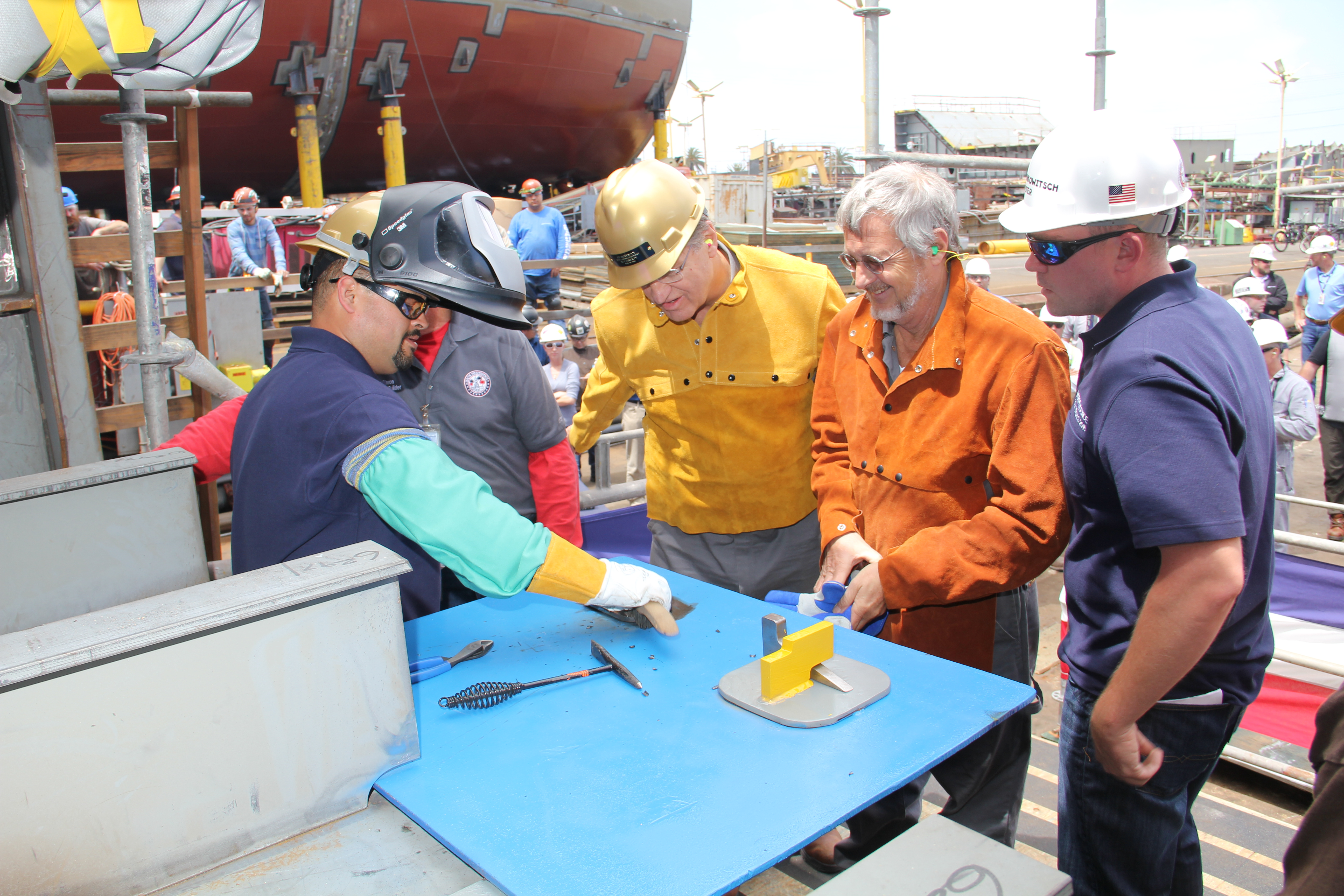 As honorees, Tom Denning, Ed Hoffman, and Tom Sofyanos — all representatives of SEA-Vista LLC — welded their initials into the keel of the ship.
