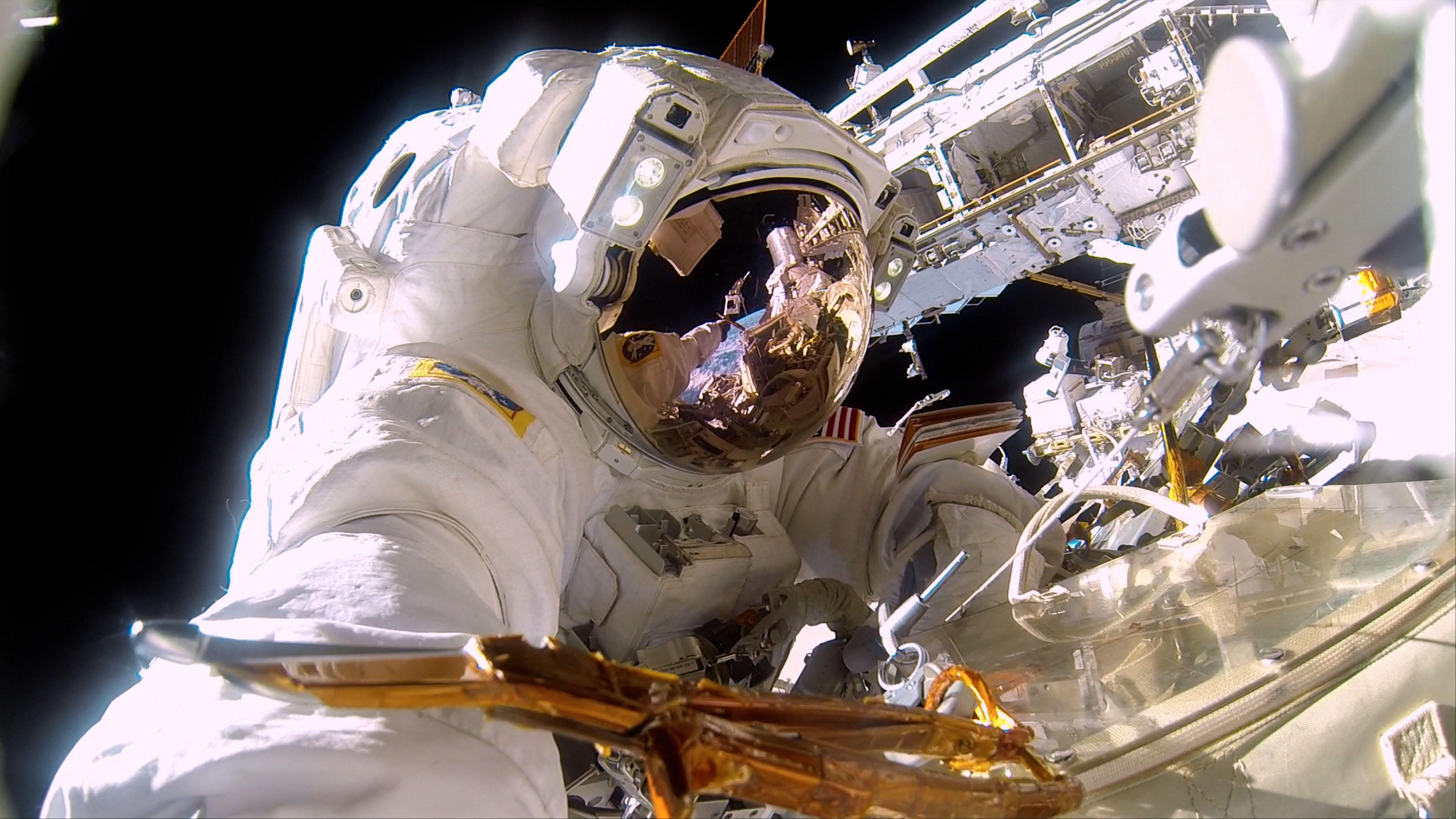 A NASA astronaut on a spacewalk to repair the exterior of the International Space Station. It's almost 300° on the sun side of the space station and -275° in the shade.