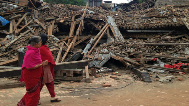 Women view devastation from the earthquake in Nepal. (Photo courtesy USAID)