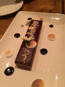 Desserts include chocolate peanut butter ball, beautifully presented.