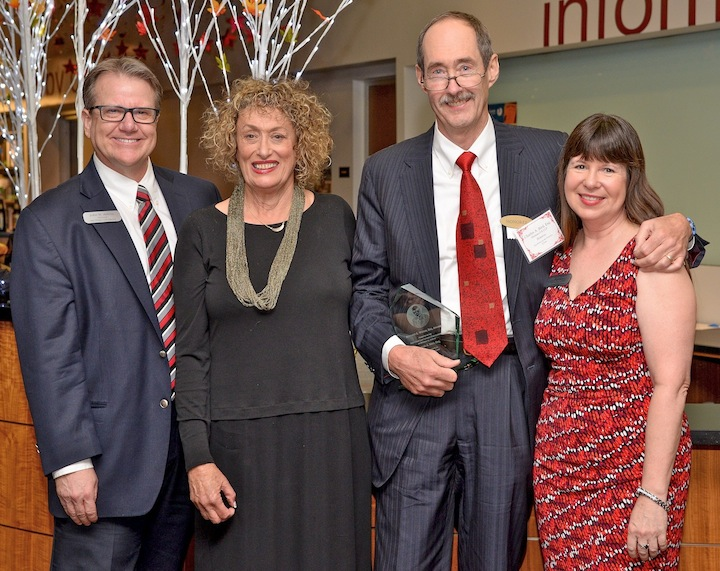 Pictured from left: Director of Libraries John Adkins, presenter alumna Susanne Stanford, awardee Charlie Bird, and Events Committee Chair Kay Catherwood. (Photo: Robin Wood/Gates Photography)