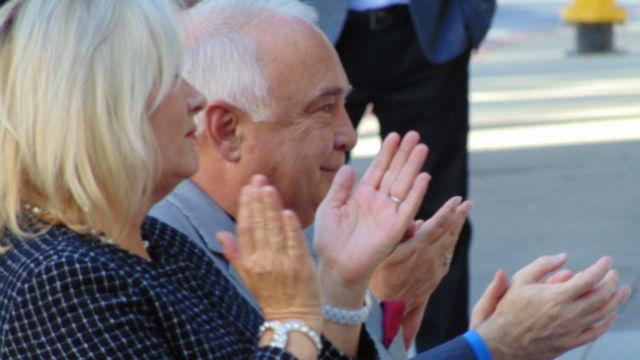 Ron and Alexis Fowler applaud during the ceremony at San Diego State University. (Photo by Chris Jennewein)