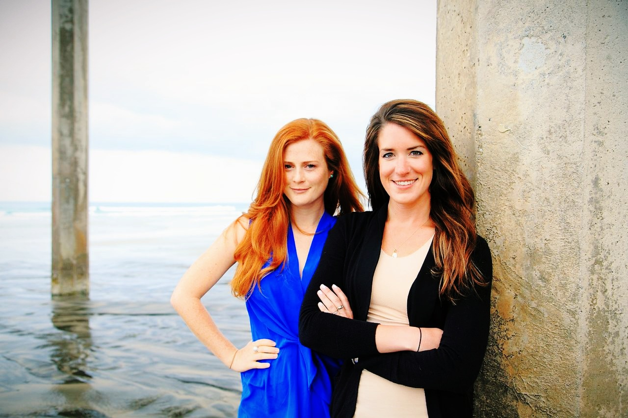Scripps alumnae Amber Jackson and Emily Callahan beneath Scripps Pier. (Photo: Theresa Stafford / Black Hand Gallery)