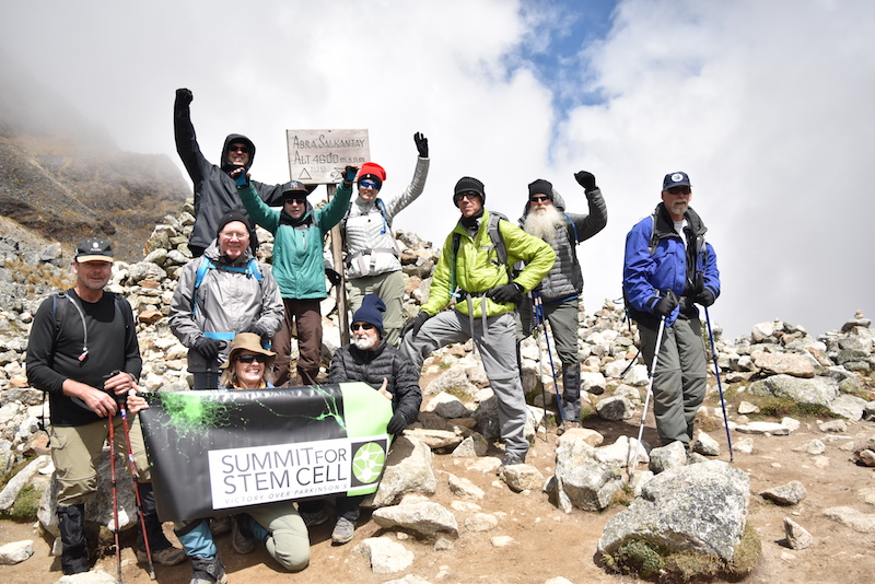 Hikers who have Parkinson's Disease celebrate at the summit.