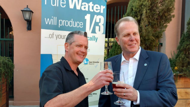 Stone Brewery's Pat Tiernan (left) and Mayor Kevin Faulconer toast with beer made from 100 percent recycled water. (Photo by Chris Jennewein/Times of San Diego)