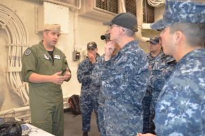 Lt. Clay Greunke, assigned to SPAWAR, explains to sailors on board the amphibious transport dock ship USS Anchorage how three-dimensional images were produced during a ship scan event of various shipboard spaces. (U.S. Navy photo by Dawn Stankus)