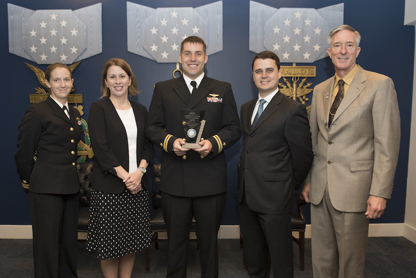 The SPAWAR 3D scanning team are recognized during the 2016 Secretary of the Navy Innovation Awards ceremony. From left, Lt. Jessica Fuller, Heidi Buck, Lt. Clay Greunke, Dr. Mark Bilinski and Stephen Cox. (U.S. Navy photo by Mass Communication Specialist 2nd Class Jonathan B. Trejo)