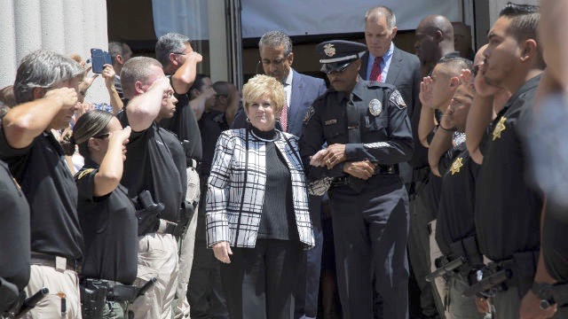 Bonnie Dumanis is saluted as she leaves her office for the last time. (Photo ourtesy of the District Attorney's Office)