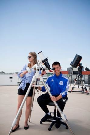 Miramar College students using a solar telescope on the roof of the college's Science Building. Similar telescopes will be available to students at each of the district's colleges.
