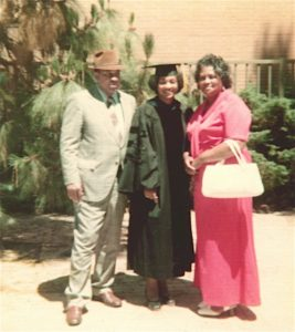 Weber received her PhD from UCLA in 1975. She appears here with her parents, David and Mildred.