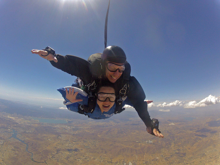 Alumna Sandy Young skydiving