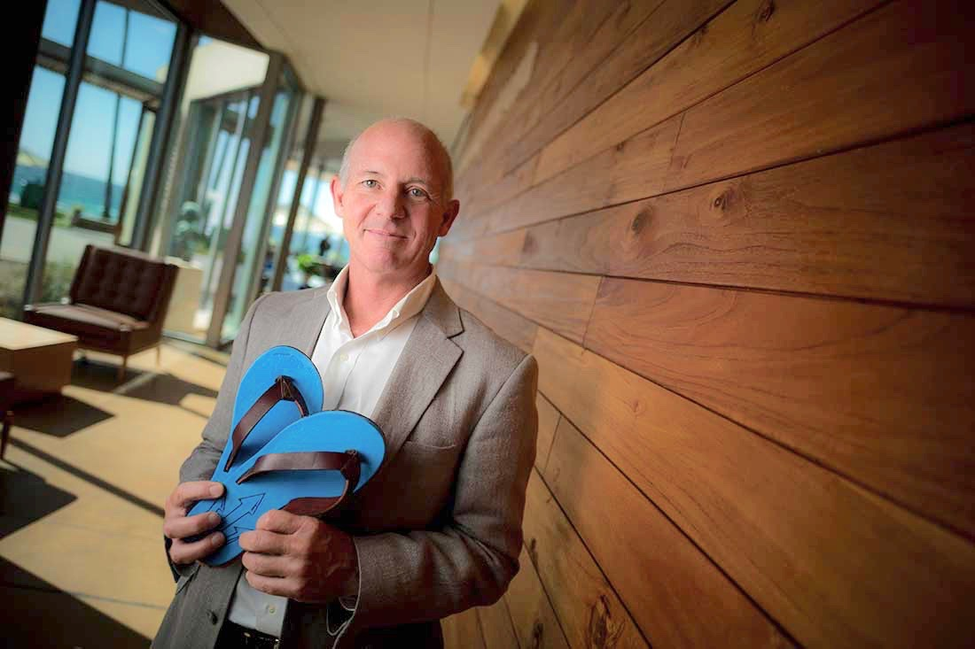 "Stephen Mayfield with Triton flip flops: ""Even though a flip flop seems like a minor product, a throwaway that everyone wears, it turns out that this is the No. 1 shoe in the world."""