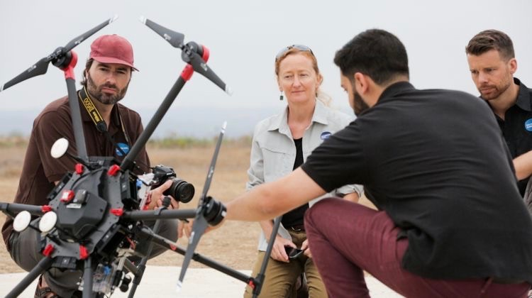 San Diego Zoo Global's science team (L-R: Dr. James Sheppard, Dr. Megan Owen, and Dr. Nicholas Pilfold) works with the Northrop Grumman technical team in the field to refine their sensor suite to meet the needs of their Arctic conservation efforts.