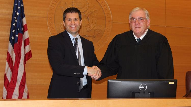 Adam Braverman is sworn in by U.S. District Judge Barry Moskowitz as interim U.S. attorney for San Diego and Imperial counties. (Courtesy of U.S. Attorney's Office)