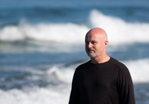 Research oceanographer Grant Deane in the surf at La Jolla Shores.