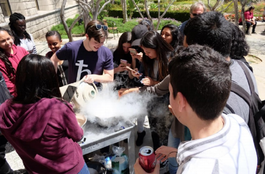 Hoover High students surround a USD student in one of the experiments. (Photo courtesy of USD)
