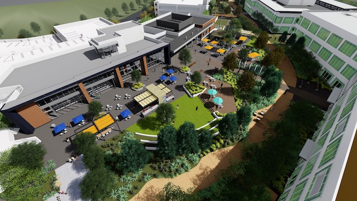 New campus courtyard incorporates green space.