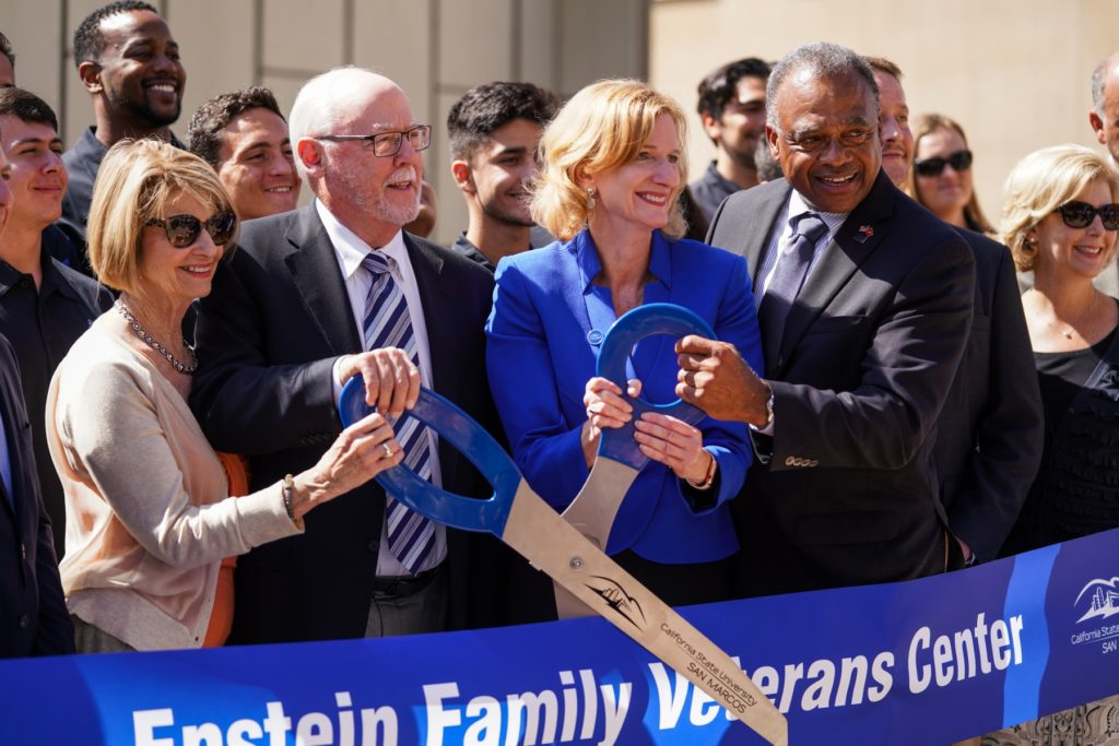 From left, Phyllis Epstein, Dan Epstein, President Ellen Neufeldt and CSUSM Foundation Board Chair Tony Jackson participate in the ribbon-cutting to celebrate the opening of the Epstein Family Veterans Center. (Photo by Andrew Reed)